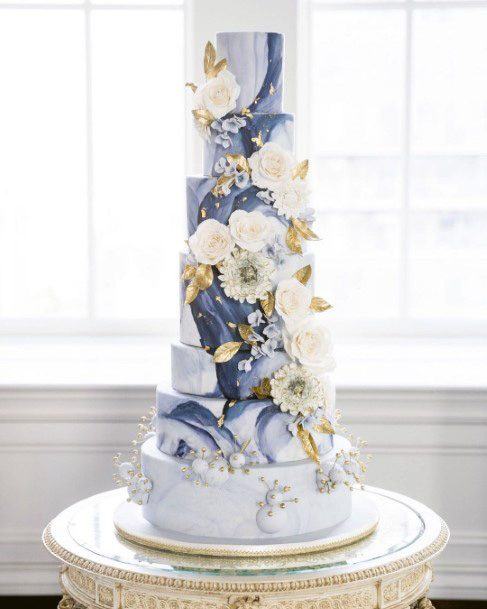 Five Tiered White And Blue Wedding Cake