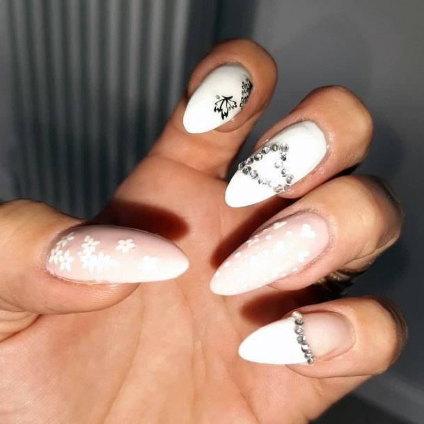 Floral Accessories And Crystals On White Gel Nails Women
