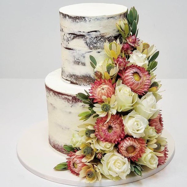 Flower Bouquet On Country Wedding Cake