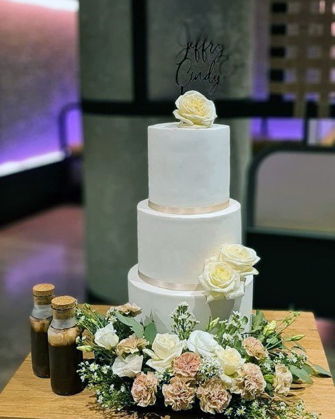 Flowers Adorned 3 Tier Wedding Cake For Women