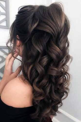 Flowing Dark Curls Hairstyle Women