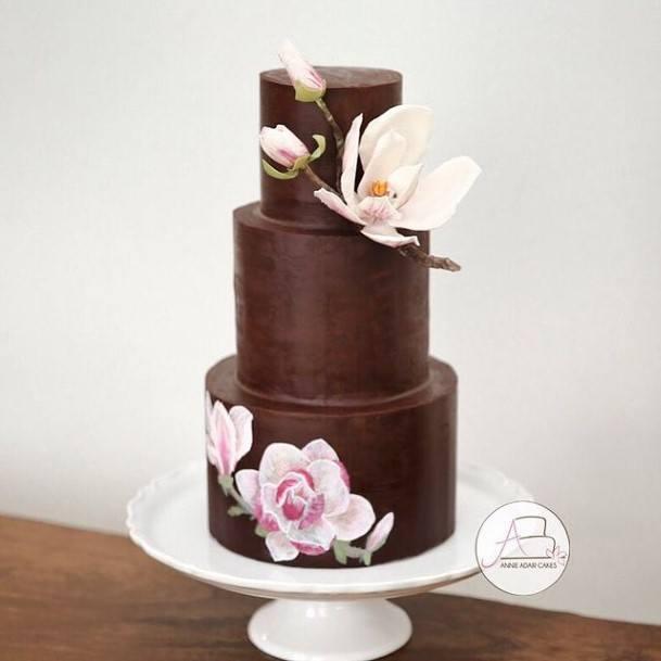 Fluttering Flowers On Chocolate Wedding Cake
