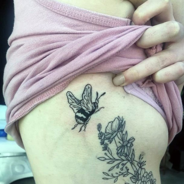 Flying Bee Over Flowers Tattoo Womens Torso Design