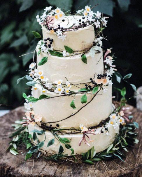 Four Tiered Cake With August Wedding Flowers