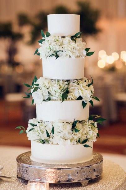Four Tiered Cake With Hydrangea Wedding Flowers
