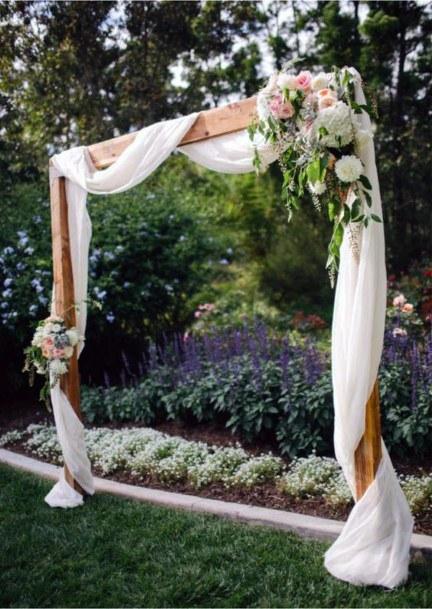 Garden Ceremony And Elegant Hand Made Arch Backyard Wedding Ideas