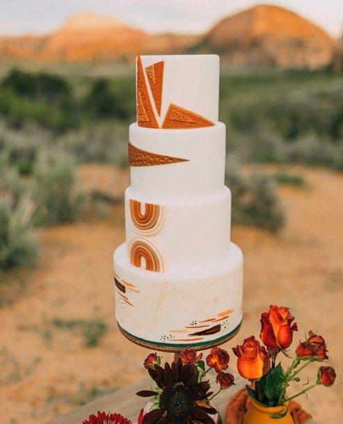 Geometric Orange Designs On Chocolate Wedding Cake