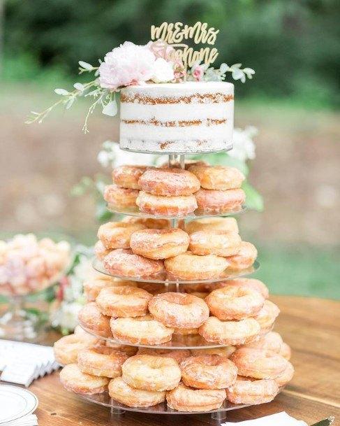 Glazed White Donuts And Wedding Cake