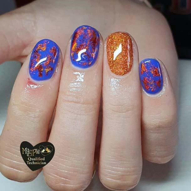 Glossy Golden Foils On Blue And Orange Nails For Women
