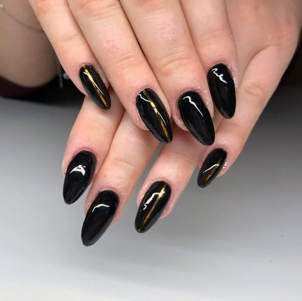 Glowing Gold Line On Stunning Black Nails For Women