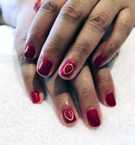 Golden Circle Art On Dark Red Nails