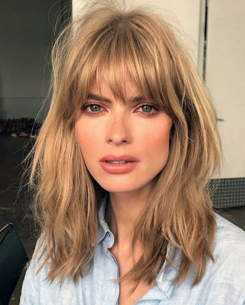Golden Locks With Center Parted Bangs Hairstyle Women