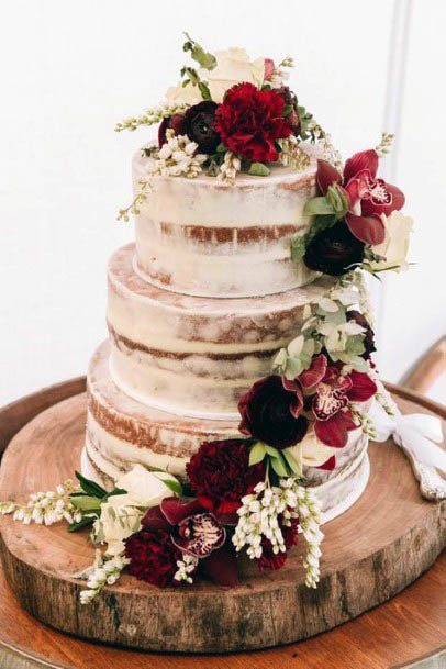 Golden Streaked Wedding Cake With Red Flowers