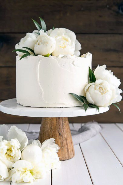 Gorgeous White Flowered Elegant Wedding Cake Women