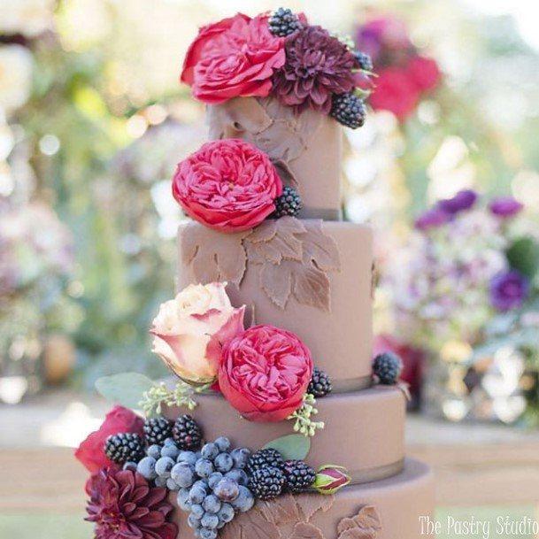 Grand Flowers On Chocolate Wedding Cake