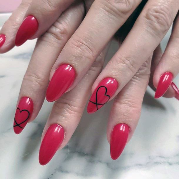Heart Design On Bright Red Nails For Women