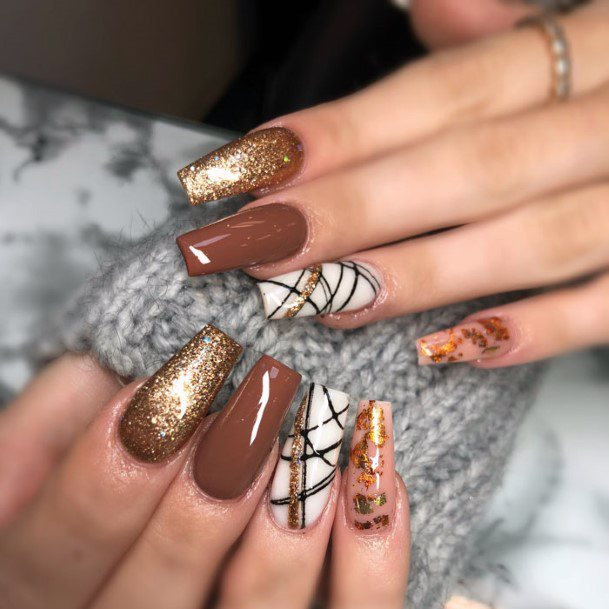 Henna Brown Polished Nails With White And Gold Design Women