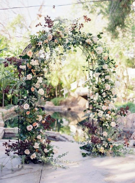 Homemade Floral And Greenery Ceremony Arch Backyard Wedding Ideas