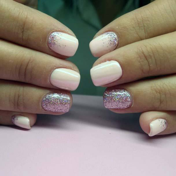 Irradiating Glitter And Light Pink Nails