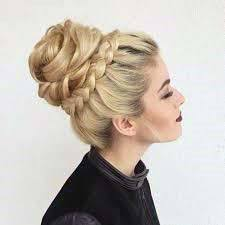 Light Blonde Female With Thick Full Hair Pulled Into Top Bun With Braided Base