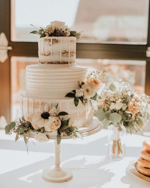 Light Cream Colored Country Wedding Cake With Roses