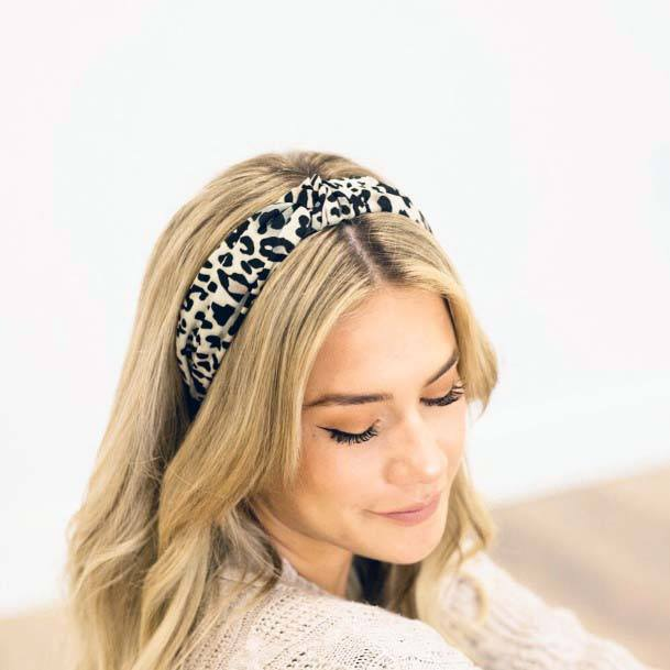 Long Blonde Haired Female With Leopard Headband