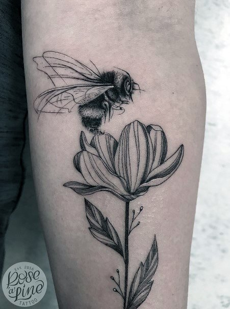 Long Stemmed Flower And Bee Tattoo For Women