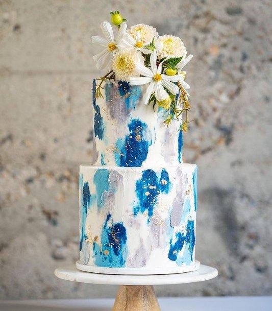 Lovely Blue Designs On White Wedding Cake