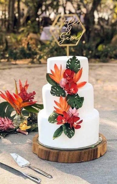 Lovely Orange Beach Wedding Flowers On Cake