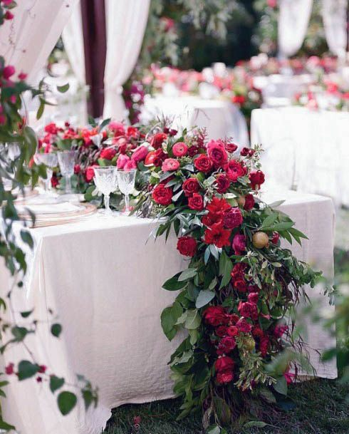 Lovely Red Flowers On Wedding Table