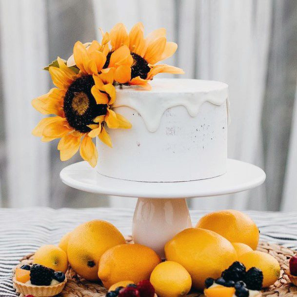 Lovely White Womens Wedding Cake With Sunflowers