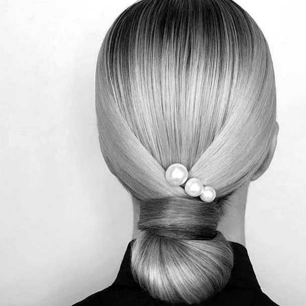 Low Hanging Chignon Hairstyle For Women