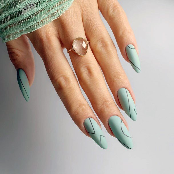 Matte Light Green Colored Nails With Black Lines