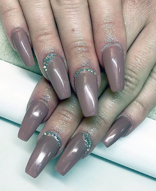 Metallic Purple Colored Nails With Crystals At Base