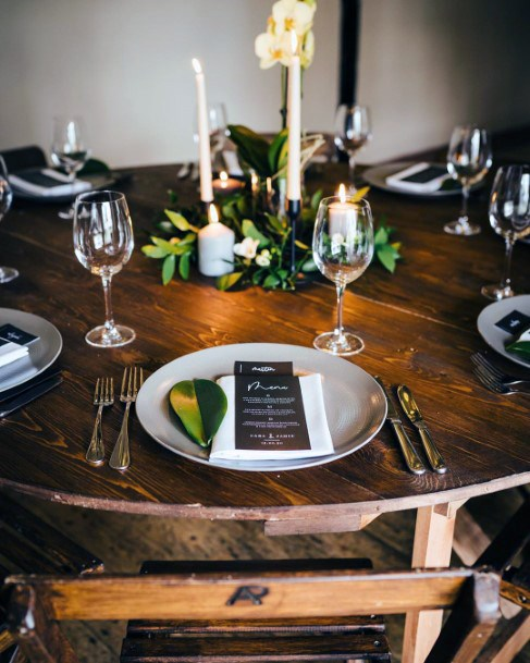 Minimal Wooden Table And Chairs With Greenery And Candle Centerpieces Rustic Wedding Ideas