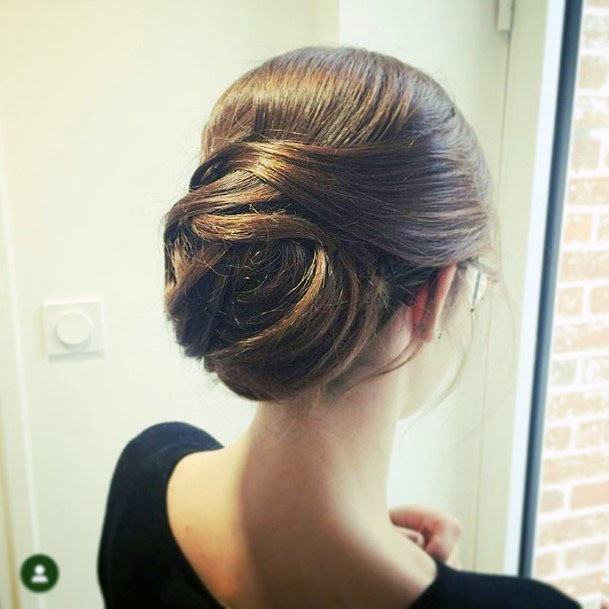 Neat Twisted Chignon Hairstyle For Women