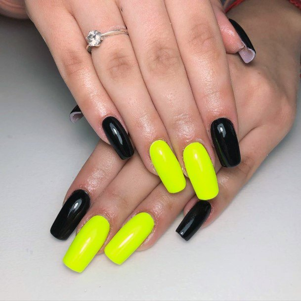 Neon Yellow And Black Colored Nails