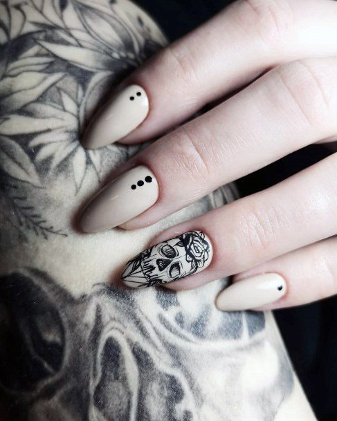 Nude Nails With Spooky Skull Art