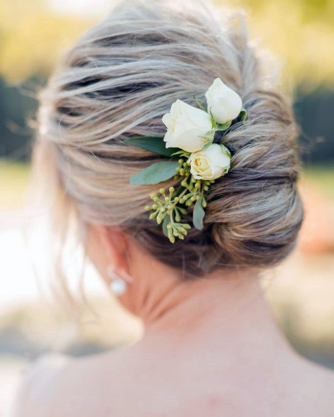Older Woman With A Flowery Bridesmaid French Twist