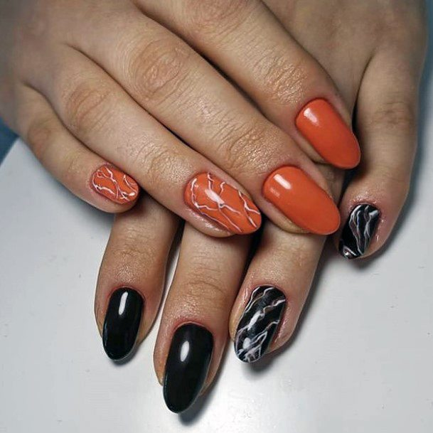 Orange And Black Lightening Design On Nails