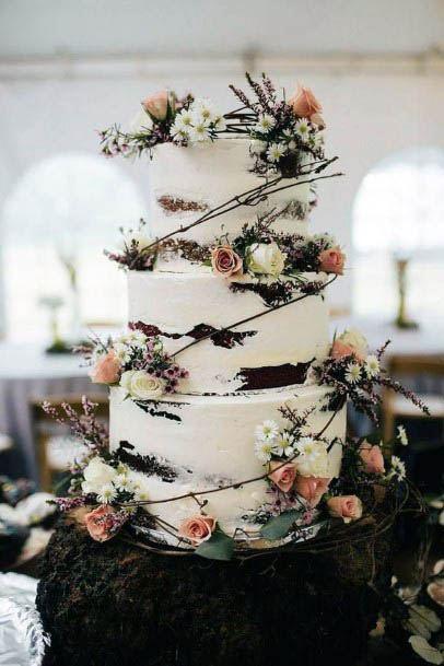 Orange And White Rustic Flowers On Wedding Cake