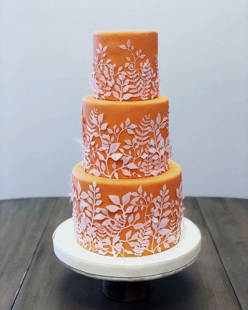 Orange Cake With Unique White Design Wedding