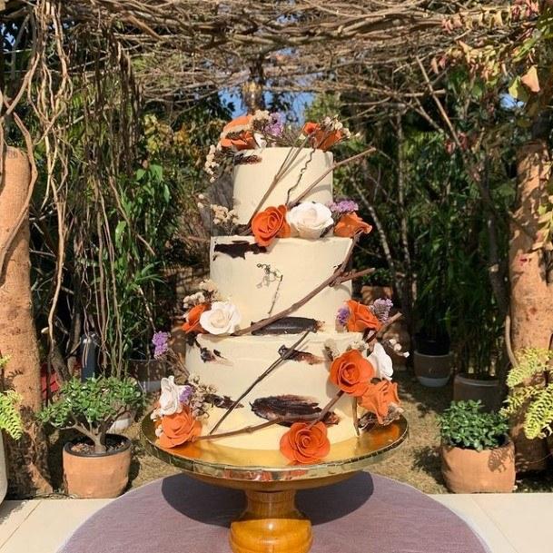 Orange Flowers Creeping On Buttercream Wedding Cake