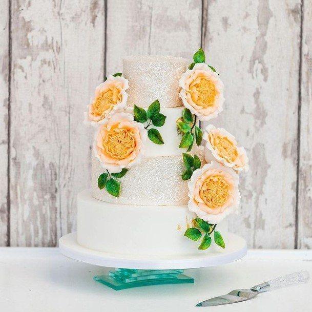 Orange Flowers On White Wedding Cake