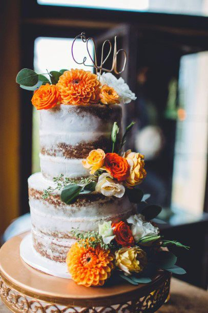 Orange Marigold November Wedding Flowers On Cake