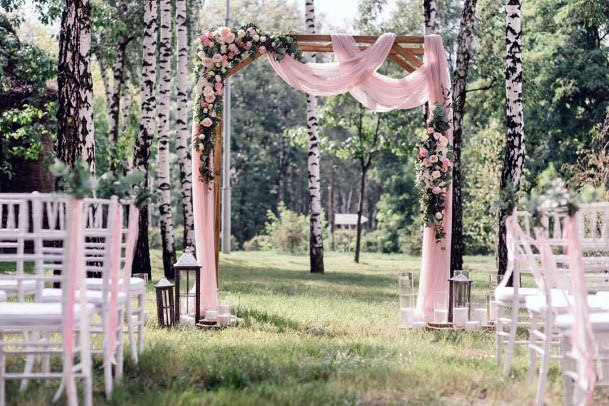 Pink Clothed Wedding Platform And Flowers