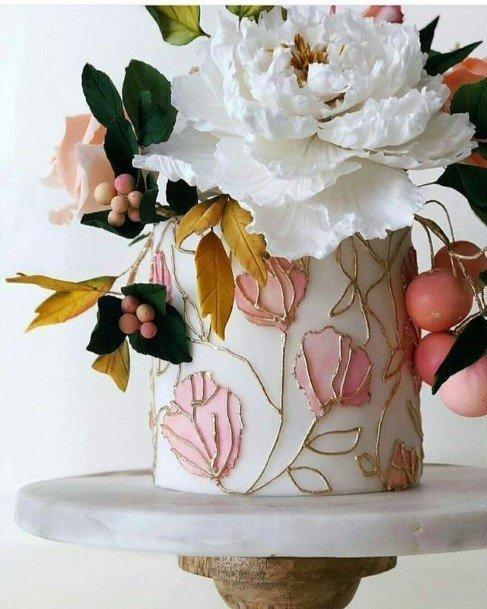 Pink Embossed Flowers On Beautiful Wedding Cake