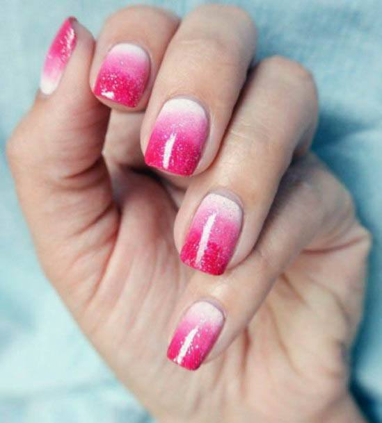 Pink Hued Ombre Nails With Tinges Of White For Women