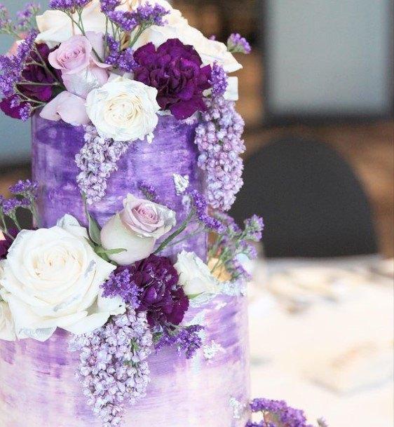 Plethora Of Purple Flowers Wedding Cake