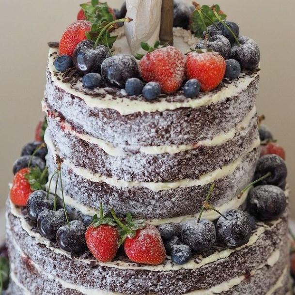 Powdered Sugar And Fruits Chocolate Wedding Cake Semi Naked